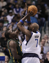Dallas Mavericks' Lamar Odom (7) goes up for a shot attempt as Utah Jazz's Paul Millsap, left, defends in the second half of an NBA basketball game on Friday, Jan. 27, 2012, in Dallas. The Mavericks won 116-101. (AP Photo/Tony Gutierrez)