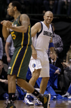 Dallas Mavericks point guard Jason Kidd, rear, reacts as he helps defend and Utah Jazz's Devin Harris, front, passes the ball in the first half of an NBA basketball game on Friday, Jan. 27, 2012, in Dallas. Kidd left the game shortly afterward with an unknown injury. (AP Photo/Tony Gutierrez)