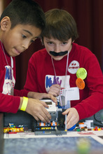 Chris Detrick  |  The Salt Lake Tribune Victor DeLeon and José Garcia, of team 'Kuku Birds,' compete during the Utah FIRST LEGO League Championship at the University of Utah Saturday January 28, 2012. Hundreds of kids ages nine to 14 -- winners from regional meets -- competed at the University of Utah, racing to complete missions with team robots and presenting research projects.