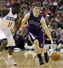 Sacramento Kings' Jimmer Fredette (7) dribbles the ball against Philadelphia 76ers' Jrue Holiday (11) in the first half of an NBA basketball game, Tuesday, Jan. 10, 2012, in Philadelphia. Philadelphia won 112-85. (AP Photo/Matt Slocum)