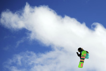 Charlotte van Gils competes in the women's snowboarding slopestyle final at the Winter X Games, Saturday, Jan. 28, 2012, in Aspen, Colo. (AP Photo/The Denver Post, AAron Ontiveroz)  MANDATORY CREDIT; MAGS OUT; TV OUT