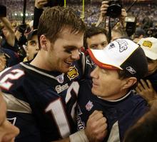 New England Patriots MVP quarterback Tom Brady (12) and head coach Bill Belichick embrace after defeating the Carolina Panthers 32-29 in Super Bowl XXXVIII in Houston, Sunday, Feb. 1, 2004. (AP Photo/David J. Phillip)