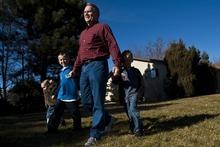 Chris Detrick  |  The Salt Lake Tribune South Jordan Mayor Scott Osborne walks with his grandkids Chenice Osborne, 2, Dakota Gibbons, 8, and Braxton Gibbons, 6, at his home in South Jordan Saturday January 14, 2012.
