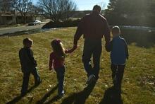 Chris Detrick  |  The Salt Lake Tribune South Jordan Mayor Scott Osborne walks with his grandkids Braxton Gibbons, 6, BrynLee Gibbons, 6, and Dakota Gibbons, 8, at his home in South Jordan Saturday January 14, 2012.