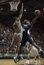 BYU's Charles Abouo (1) right, is fouled by Virginia Tech's Jarell Eddie (31) left, during first-half NCAA college basketball game action in Blacksburg, Va., Wednesday, Jan. 25 2012. (AP Photo/The Roanoke Times, Matt Gentry)