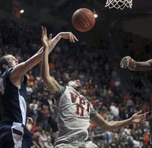 Tech's Erick Green (11) has his final shot at the basket blocked by BYU's Noah Hartsock (34) left, in the final seconds of the second-half NCAA college basketball game action in Blacksburg, Va., Wednesday, Jan. 25 2012. BYU won 70-68. (AP Photo/The Roanoke Times, Matt Gentry)