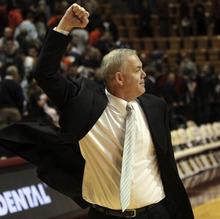 BYU head coach Dave Rose pumps his fist toward after winning an NCAA college basketball game against Virginia Tech in Blacksburg, Va., Wednesday, Jan. 25 2012. BYU won 70-68. (AP Photo/The Roanoke Times, Matt Gentry)