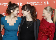 Actress Lake Bell, left, actress and director Katie Aselton, center, and actress Kate Bosworth, right, laugh together as they pose at the premiere of