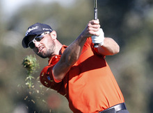 Kyle Stanley watches his approach shot on the second hole of the South Course at Torrey Pines during the third round of the Farmers Insurance Open golf tournament Saturday, Jan. 28, 2012 in San Diego. (AP Photo/Lenny Ignelzi )