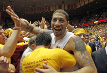 Iowa State's Royce White is mobbed by students that stormed the court after their 72-64 win over Kansas in an NCAA college basketball game at Hilton Coliseum in Ames, Iowa, Saturday afternoon, Jan. 28,. 2012 (AP Photo/The Des Moines Register, Justin Hayworth) NO SALES