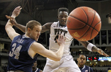 The ball gets by Georgetown's Nate Lubick (34) and Pittsburgh's Talib Zanna as they go for a rebound in the first half of the NCAA college basketball game on Saturday, Jan. 28, 2012, in Pittsburgh. (AP Photo/Keith Srakocic)