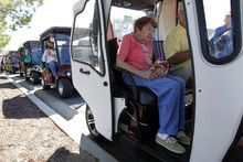 Residents arrive in golf carts for a campaign event by Republican presidential candidate, former House Speaker Newt Gingrich, at the The Villages, Sunday, Jan. 29, 2012, in Lady Lake, Fla. (AP Photo/Matt Rourke)