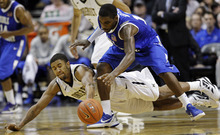 Vanderbilt's Kedren Johnson, below, battles for the ball with Middle Tennessee's Shawn Jones in the second half of an NCAA college basketball game on Saturday, Jan. 28, 2012, in Nashville, Tenn. Vanderbilt 84-77. (AP Photo/Wade Payne)