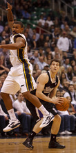 Trent Nelson  |  The Salt Lake Tribune Sacramento's Jimmer Fredette looks for a shot in the first half, with Utah Jazz guard Earl Watson (11) defending, Saturday at the EnergySolutions Arena in Salt Lake City. The Jazz downed the Kings, 96-93.