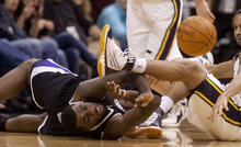 Trent Nelson  |  The Salt Lake Tribune Sacramento's Donte Greene looks for the loose ball with Utah Jazz guard Devin Harris (5) at right, in the first quarter Saturday at the EnergySolutions Arena in Salt Lake City. The Jazz downed the Kings, 96-93.