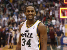 Trent Nelson  |  The Salt Lake Tribune Utah Jazz guard/forward C.J. Miles (34) celebrates the win with a smile Saturday after the Jazz beat Sacramento 96-93 at the EnergySolutions Arena in Salt Lake City.