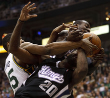 Trent Nelson  |  The Salt Lake Tribune Sacramento's Donte Greene (20) gets tangled up with teammate J.J. Hickson and Utah Jazz forward Derrick Favors (15) in the second half of game Saturday at the EnergySolutions Arena in Salt Lake City. The Jazz downed the Kings, 96-93.