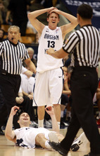 BYU'S Brock Zylstra (13) reacts as a charging foul is called on Matt Carlino (10) in second half action of an NCAA college basketball game in the Marriott Center in Provo, Utah Saturday, Jan. 28, 2012. (AP Photo/The Salt Lake Tribune, Rick Egan)