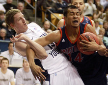 BYU guard, Brock Zylstra (13) gets tangles up with Saint  Mary's guard Stephen Holt (14),  during an NCAA college basketball game at the Marriott Center in Provo, Utah Saturday, Jan. 28, 2012. (AP Photo/The Salt Lake Tribune, Rick Egan)