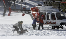 Francisco Kjolseth  |  The Salt Lake Tribune A local highly-trained avalanche rescue dog unloads at Dog lake at Brighton at the top of Big Cottonwood Canyon on Wednesday, January 25, 2012 to do avalanche victim search drills, beacon searches, helicopter training and classroom sessions conducted by Wasatch Backcountry Rescue (WBR).