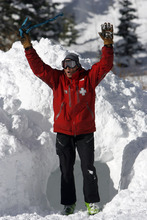 Francisco Kjolseth  |  The Salt Lake Tribune Paul Santana with the Canyon's search and rescue works with a young avalanche dog in training as he excitedly throws his arms in the air to get its attention before jumping into a snow hole. Local teams of highly-trained avalanche rescue dogs and their handlers gather at Brighton at the top of Big Cottonwood Canyon on Wednesday, January 25, 2012 to do avalanche victim search drills, beacon searches, helicopter training and classroom sessions conducted by Wasatch Backcountry Rescue (WBR).