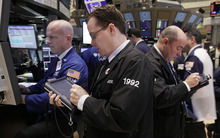 Traders work on the floor of the New York Stock Exchange Monday, Jan. 30, 2012. Uncertainty about a deal between Greece and its creditors to ease its debt burden is weighing on investor sentiment. (AP Photo/Richard Drew)