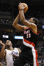 Portland Trail Blazers center Marcus Camby (23) shoots over Utah Jazz forward Derrick Favors (15) during the first half of an NBA basketball game Monday, Jan. 30, 2012, in Salt Lake City. (AP Photo/Jim Urquhart)