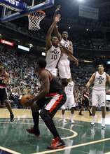 Portland Trail Blazers guard Wesley Matthews (2) is defended on a shot attempt by Utah Jazz guard Alec Burks (10) and forward Jeremy Evans (40) during the first half of an NBA basketball game Monday, Jan. 30, 2012, in Salt Lake City. (AP Photo/Jim Urquhart)