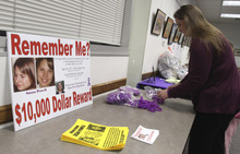 Rick Egan  | The Salt Lake Tribune   Jennifer Graves sets up a table Monday for people to leave donations. Friends and family of missing West Valley City woman Susan Cox Powell gathered donations for the Christmas Box House, at the Hunter Library in West Valley City.