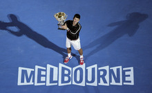 Novak Djokovic of Serbia holds the trophy during the awarding ceremony after defeating Rafael Nadal of Spain  in the men's singles final at the Australian Open tennis championship, in Melbourne, Australia, early Monday, Jan. 30, 2012. (AP Photo/John Donegan)