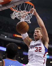 Los Angeles Clippers forward Blake Griffin, right, dunks as Oklahoma City Thunder guard Reggie Jackson looks on during the first half of an NBA basketball game in Los Angeles, Monday, Jan. 30, 2012. (AP Photo/Chris Carlson)