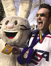 Courtesy Sarah Morton  |  Marriott Library, U. of Utah Powder, one of the 2002 Winter Olympic Games mascot, poses with a member of the bronze-medal-winning U.S. Hockey team at the Olympic Village. The photo is one of those collected in