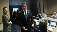Republican presidential candidate, former Massachusetts Gov. Mitt Romney, visits with campaign workers in his