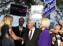 Republican presidential candidate, former House Speaker Newt Gingrich, accompanied by his wife Callista, campaigns outside a polling place at the First Baptist Church of Windermere in Orlando, Fla., Tuesday, Jan. 31, 2012. (AP Photo/Matt Rourke)