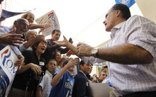Republican presidential candidate, former Massachusetts Gov. Mitt Romney, campaigns at Sugden Plaza in Naples, Fla., Sunday, Jan. 29, 2012. (AP Photo/Charles Dharapak)