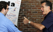 Republican presidential candidate, former Massachusetts Gov. Mitt Romney gives a thumbs up as he greets volunteers at his campaign office in Tampa, Fla., Tuesday, Jan. 31, 2012, during Florida's primary election day. (AP Photo/Charles Dharapak)