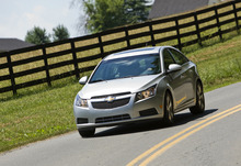 This photo provided by General Motors Co., shows the 2012 Chevrolet Cruze LT on a drives in Haymarket, Virginia. General Motors Co. said Wednesday, Feb. 1, 2012, its U.S. sales fell 6 percent in January compared to a strong month a year ago. (AP Photo, General Motors Co., Mark Finkenstaedt)
