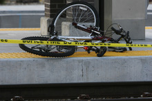 Francisco Kjolseth  |  The Salt Lake Tribune A bicyclist was killed after being dragged under by a West bound TRAX train at the Redwood Junction station at 1740 West, Research Way near 2770 South and Redwood on Monday morning, November, 7, 2011,  with the first 911 call being made at 6:47 a.m. The crash involved the Green Line train, running from downtown Salt Lake City to West Valley City.