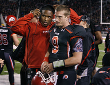 Scott Sommerdorf  |  The Salt Lake Tribune              Utah quarterbacks coach Brian Johnson talks with QB Jon Hays after the offense came off the field in the third quarter. Utah defeated Oregon State 27-8, Saturday, October 29, 2011