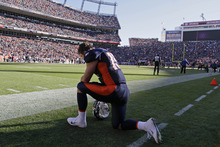 Denver Broncos quarterback Tim Tebow (15) kneels and prays before the start of an NFL football game against the Chicago Bears, Sunday, Dec. 11, 2011, in Denver. (AP Photo/Joe Mahoney)