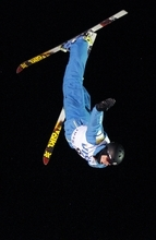 Dylan Ferguson, of the United States, flips during his run during the men's aerial final at the World Cup Freestyle skiing competition Friday, Feb. 3, 2012, at Deer Valley Resort in Park City, Utah. Ferguson finished second. (AP Photo/Jim Urquhart)