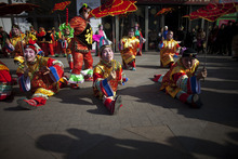 Performers dance in celebration of the upcoming Lantern Festival outside a shopping mall in Beijing, China, Friday, Feb. 3, 2012. The Lantern Festival, which falls on Feb. 6, 2012, marks the 15th and final day of the Spring Festival, the annual celebration of the beginning of the Lunar New Year. (AP Photo/Alexander F. Yuan)