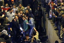 An injured man is carried after arriving from Port Said at a train station in Cairo, Egypt, Thursday, Feb. 2, 2012. Witnesses say scores of Egyptian soccer fans were stabbed to death while others suffocated, trapped in a long narrow corridor trying to flee rival fans armed with knives, clubs and stones in the country's worst ever soccer violence. At least 74 people died and hundreds were injured after Wednesday's game in the seaside city of Port Said, when disgruntled fans of the home team, Al Masry, rushed the pitch, setting off clashes and a stampede as riot police largely failed to intervene. (AP Photo)