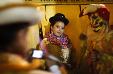 A Chola poses for pictures during an event to elect carnival characters known as Chuta, Pepino and Chola in La Paz, Bolivia, Thursday Feb. 2, 2012. (AP Photo/Juan Karita)