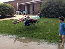 In this photo released by Jess Dawson, a man takes advantage of high flood waters to fish from his front lawn in Moree, Northern New South Wales, Australia, Friday, Feb. 3, 2012. Helicopters and rescue crew are on standby to evacuate people as the Mehi River near Moree is expected to swell higher as flooding in northwestern NSW continues. (AP Photo/Jess Dawson) EDITORIAL USE ONLY