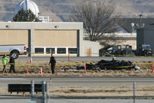 Emergency personnel look over the wreckage of a Lancair aircraft that crashed at the Boise Airport Friday morning, Feb. 3, 2012, in Boise, Idaho, killing Steve Appleton, the chief executive and chairman of Micron, the company said. He was 51.  Officials at the airport say the experimental aircraft crashed between two runways. (AP Photo/The Idaho Statesman, Joe Jaszewski) MANDATORY CREDIT
