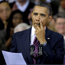 President Barack Obama pauses while speaking at the James Lee Community Center in Falls Church, Va., Wednesday, Feb. 1, 2012. (AP Photo/Cliff Owen)