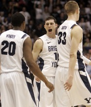Kim Raff |The Salt Lake Tribune BYU player Matt Carlino celebrates during the first half against Gonzaga at the Marriott Center in Provo, Utah on February 2, 2012.