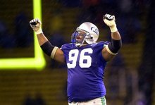 FILE- In this Dec. 16, 2000, file photo, Seattle Seahawks defensive tackle Cortez Kennedy (96) celebrates Seattle's 27-24 victory over the Oakland Raiders in an NFL football game in Seattle. Kennedy was elected to the Pro Football Hall of Fame on  Saturday, Feb. 4, 2012. (AP Photo/Cheryl Hatch, File)