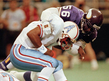 FILE - In this Aug. 27, 1990, file photo, Minnesota Vikings linebacker Chris Doleman (56) brings down Houston Oilers quarterback Warren Moon for a safety during preseason NFL football action in Minneapolis. Doleman is not one of the four Pro Football Hall of Fame finalists who won a Super Bowl. He doesn't believe that should affect his chances of being elected to the shrine.  (AP Photo/Jim Mone, File)